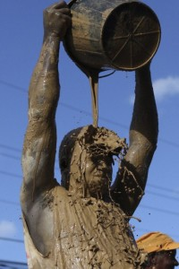 A reveller covers himself with mud during the Jouvert morning party in Port of Spain